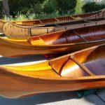 four in driveway canoe